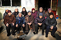 ELDERLY VILLAGERS WARM THEMSELVES IN THE SUN FOLLOWING AN IMPROMPTU SERVICE IN THEIR VILLAGE IN HENAN PROVINCE, CHINA...JAN 2010....FILENAME:CHINA155....CLARE KENDALL..07971 477316