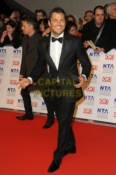 Mark Wright.arrivals at The National Television Awards, O2 Greenwich, London, England. 25th January 2012.NTA NTAS full length black white bow tie hands arms tuxedo .CAP/CAS.©Bob Cass/Capital Pictures.