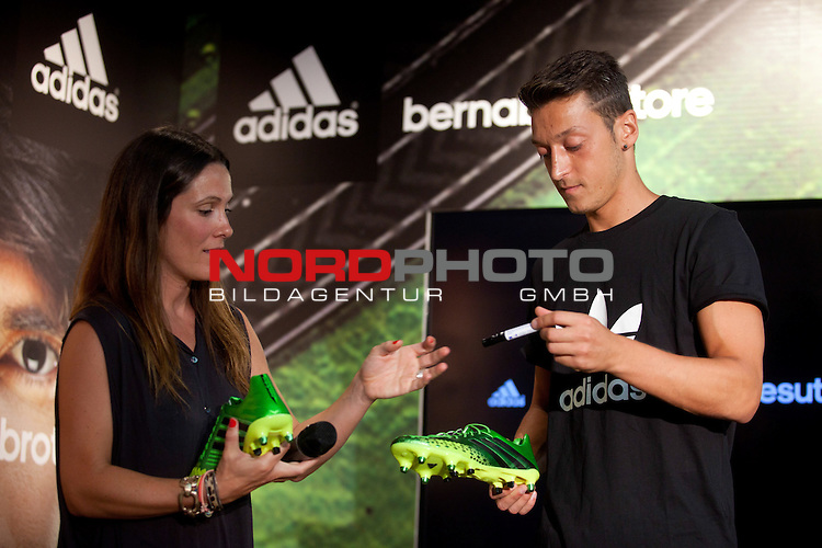 The Real Madrid player Mesut Ozil, is presented as new image of the sports brand Adidas at Bernabeu Store in Madrid. August 28, 2013. Foto © nph / Caro Marin)