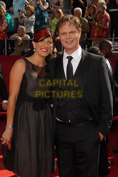GUEST & RAINN  WILSON .The 60th Annual Primetime Emmy Awards held at The Nokia Theatre in Los Angeles, California, USA, .September 21st 2008.                                                                     .emmys red carpet arrivals half length black dress suit tie .CAP/DVS.©Debbie VanStory/Capital Pictures