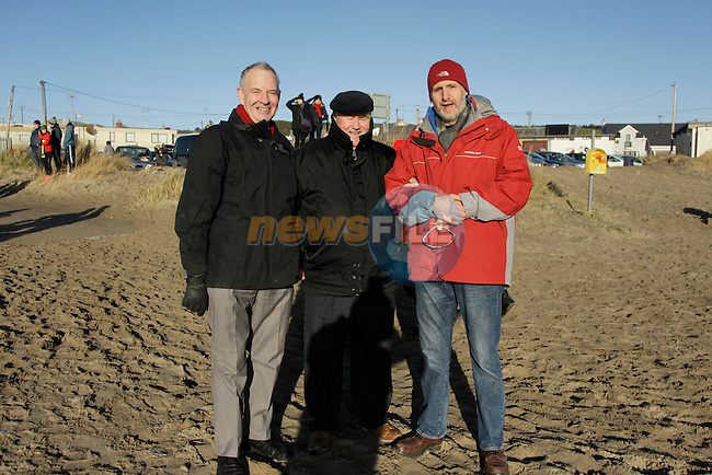 Cllr Oliver Tully, Aiden Sharkey and Ray Donagh during the St. Stephen's Day 2013 swim for Chernobyl on Clogherhead beach.<br />