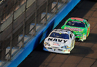 Apr 11, 2008; Avondale, AZ, USA; NASCAR Nationwide Series driver Brad Keselowski (88) leads Kyle Busch during the Bashas Supermarkets 200 at the Phoenix International Raceway. Mandatory Credit: Mark J. Rebilas-