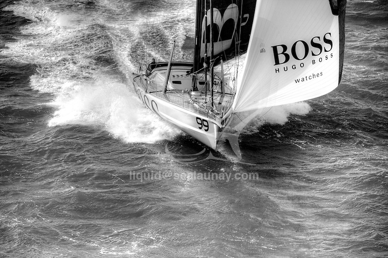 Aerial photo-shoot of the IMOCA Open 60 Alex Thomson Racing Hugo Boss during a training session before the Vendée Globe in the English Channel..The Vendée Globe is a round-the-world single-handed yacht race, sailed non-stop and without assistance.