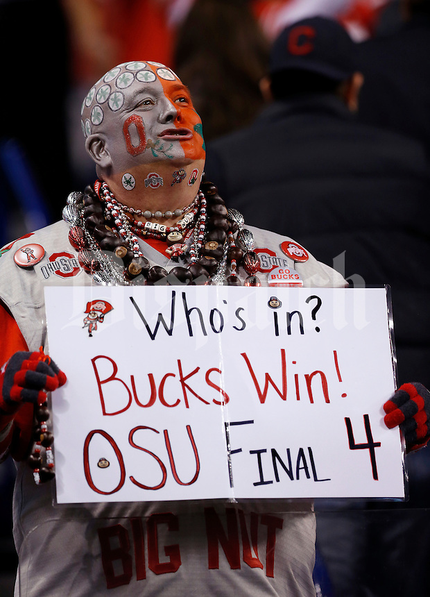 Jon Peters, aka Big Nut, holds a sign predicting Ohio State will make the College Football Playoff during the third quarter of the Big Ten Championship game against the Wisconsin Badgers at Lucas Oil Stadium in Indianapolis on Dec. 6, 2014. (Adam Cairns / The Columbus Dispatch)