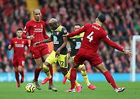 1st February 2020; Anfield, Liverpool, Merseyside, England; English Premier League Football, Liverpool versus Southampton; Moussa Djenepo of Southampton takes on Fabinho and Virgil van Dijk of Liverpool