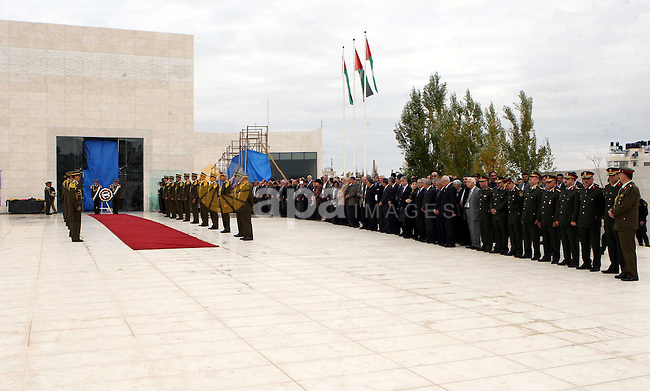 Palestinian government officials lining up during a wreath laying ceremony at the mausoleum of the late Palestinian President and PLO Chairman Yasser Arafat in the West Bank town of Ramallah, 27 November 2012. The body of former Palestinian president Yasser Arafat was exhumed Tuesday, part of efforts by an international team investigating claims that he had died of poisoning, Voice of Palestine Radio reported. French, Swiss and Russian experts, who flew to Ramallah to conduct the probe, were taking samples. The body of the former president is to be re-interred later in the day in a military ceremony. The results of the tests are expected to be known within days, or by the end of the year at the latest. Arafat died at the age of 75 in a French hospital on November 11, 2004. Medical records show he died of a brain hemorrhage, caused by a bowel infection. Some Palestinians blame Israel for his death, a claim Israel has strenuously denied. Photo by Thaer Ganaim