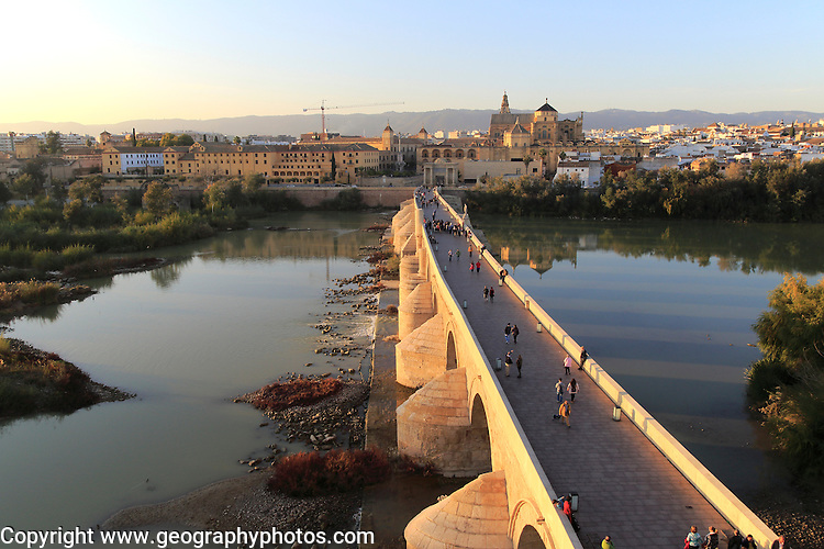 Roman bridge river Rio Guadalquivir with Mezquita cathedral buildings, Cordoba, Spain