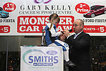 Anastasia Palomo with comedian Alan Short at the Launch of the Monster Car Draw in aid of the Gary Kelly Centre at Smiths Garage....Photo NEWSFILE/Jenny Matthews.