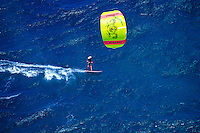 A kitesurfer kitesurfing on the north shore of Maui