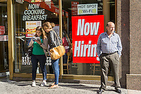 A sign in the window of a Wendy's in New York advises potential job applicants of the opportunities available in the fast food industry, seen on Friday, September 25, 2015.  (© Richard B. Levine)