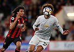 Nathan Ake of Bournemouth tussles with Marouane Fellaini of Manchester United during the premier league match at the Vitality Stadium, Bournemouth. Picture date 18th April 2018. Picture credit should read: David Klein/Sportimage