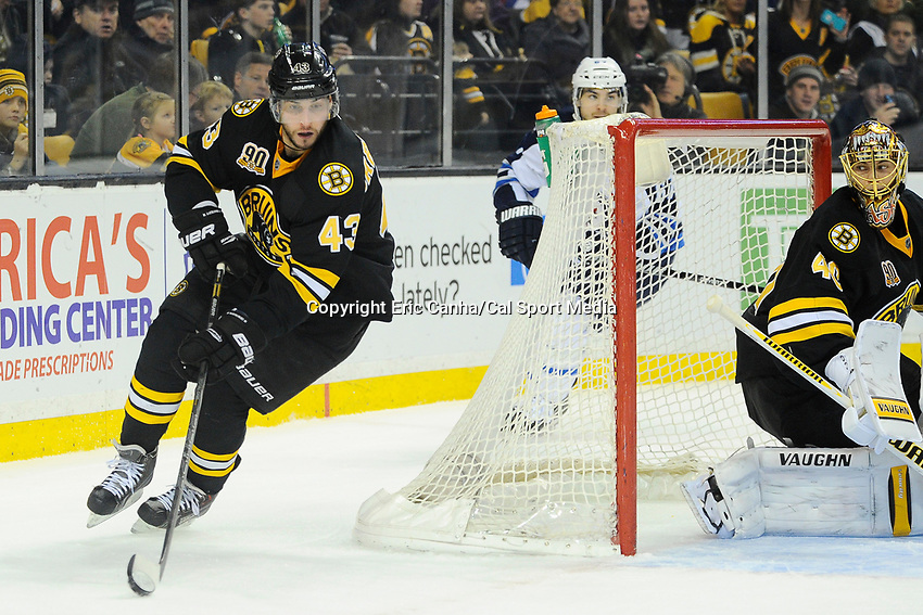 January 2, 2014 - Boston, Massachusetts, U.S. - Boston Bruins defenseman Matt Bartkowski (43) works to clear the puck during the NHL game between Winnipeg Jets and the Boston Bruins held at TD Garden in Boston Massachusetts.  Boston defeated Winnipeg 4-1 in regulation. Eric Canha/CSM