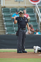 Home plate umpire Rene Gallegos makes a strike call during the South Atlantic League game between the Lexington Legends and the Kannapolis Intimidators at Kannapolis Intimidators Stadium on August 4, 2019 in Kannapolis, North Carolina. The Legends defeated the Intimidators 5-1. (Brian Westerholt/Four Seam Images)