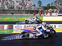 Mar 14, 2014; Gainesville, FL, USA; NHRA pro stock motorcycle rider Hector Arana Jr (near lane) races alongside brother Adam Arana during qualifying for the Gatornationals at Gainesville Raceway Mandatory Credit: Mark J. Rebilas-USA TODAY Sports