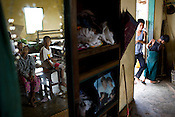 Refugees from the Falan village in Kyauktan township take shelter in the Middle school that has been temporarily transformed as a refuge for 18 families and 140 people. .