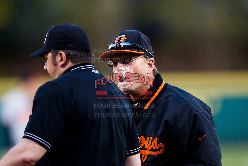 Head Coach Frank Anderson (3) of the Oklahoma State Cowboys argues with Home plate umpire John Brammer (24) during a game against the Missouri State Bears at Hammons Field on March 6, 2012 in Springfield, Missouri. (David Welker / Four Seam Images).
