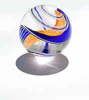 Colorful blue, orange, and white glass marbles