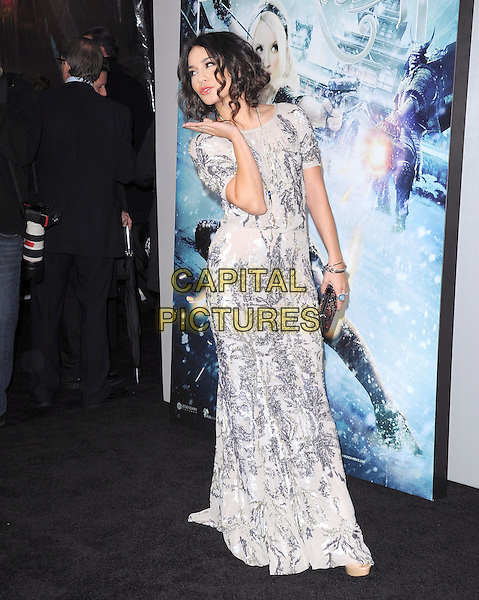 "VANESSA HUDGENS .at The Warner Bros. Pictures World Premiere of ""Sucker Punch"" held at The Grauman's Chinese Theatre in Hollywood, California, USA,.March 23rd 2011..full length dress   grey gray silver gold sequined sequin hand blowing kiss gesture ring bracelets clutch bag long maxi                    .CAP/RKE/DVS.©DVS/RockinExposures/Capital Pictures."