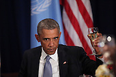 United States President Barack Obama offers a toast as he attends a luncheon hosted by United Nations Secretary-General Ban Ki-moon at the United Nations 69th General Assembly. <br /> Credit: Allan Tannenbaum / Pool via CNP
