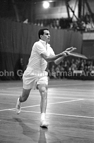 American tennis player Dick Savitt in action at the National Indoor Tennis Championship, 7th Regiment Armory, New York City, 1959. Photograph by John G. Zimmerman.