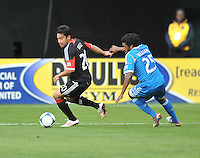 Carlos Ruiz (20) of D.C. United goes against Sheanon Williams (25) of the Philadelphia Union. The Philadelphia Union defeated D.C. United 3-2, at RFK Stadium, Sunday April 21, 2013.