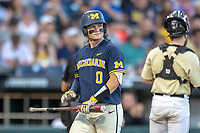 Michigan Wolverines catcher Joe Donovan (0) walks back to the dugout against the Vanderbilt Commodores during Game 3 of the NCAA College World Series Finals on June 26, 2019 at TD Ameritrade Park in Omaha, Nebraska. Vanderbilt defeated Michigan 8-2 to win the National Championship. (Andrew Woolley/Four Seam Images)