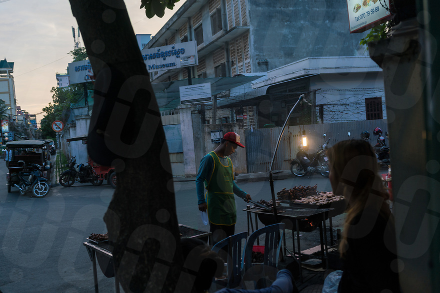 June 11, 2017 - Phnom Penh (Cambodia). A barbecue a restaurant in front of the gate of the Tuol Sleng, the former school converted into a prison by the Khmer Rouge. © Thomas Cristofoletti / Ruom