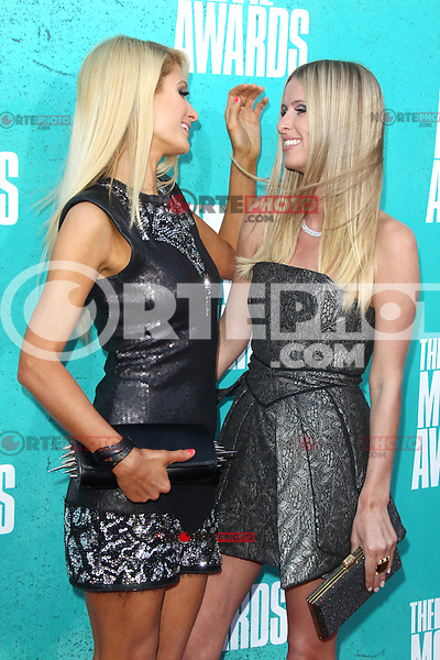 Paris Hilton and Nicky Hilton at the 2012 MTV Movie Awards held at Gibson Amphitheatre on June 3, 2012 in Universal City, California. © mpi29/MediaPunch Inc.