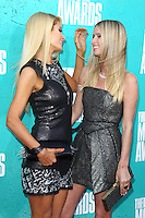 Paris Hilton and Nicky Hilton at the 2012 MTV Movie Awards held at Gibson Amphitheatre on June 3, 2012 in Universal City, California. ©mpi29/MediaPunch Inc.