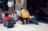 British Transport police officer knelt down talking to a down and out that has fallen over from excess alcohol on the concourse of a British Rail mainline station. This image may only be used to portray the subject in a positive manner..©shoutpictures.com..john@shoutpictures.com
