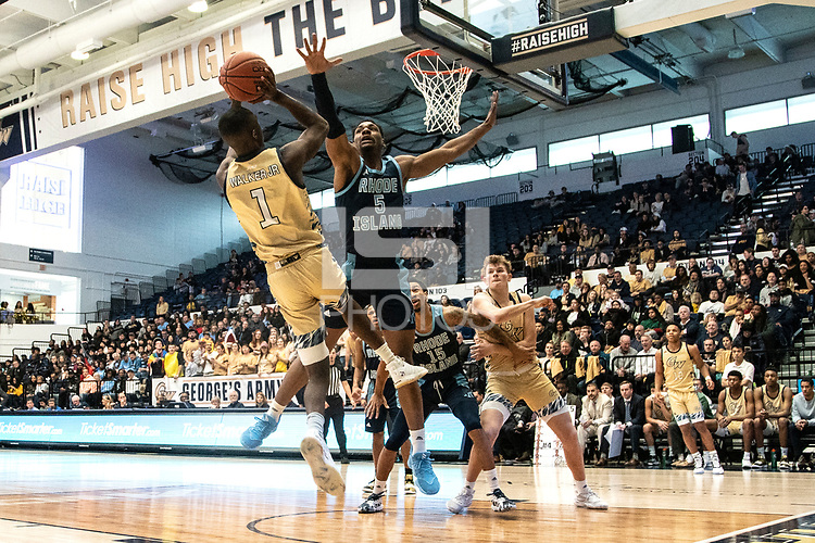 WASHINGTON, DC - FEBRUARY 8: Antwan Walker #5 of Rhode Island leaps up to defend against  shot by Shawn Walker Jr. #1 of George Washington during a game between Rhode Island and George Washington at Charles E Smith Center on February 8, 2020 in Washington, DC.