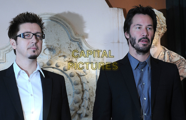 "SCOTT DERRICKSON & KEANU REEVES .Photocall for ""The Day The Earth Stood Still"", Eden Hotel, Rome, Italy..December 1st, 2008.half length black suit jacket glasses beard goatee facial hair .CAP/CAV.©Luca Cavallari/Capital Pictures."