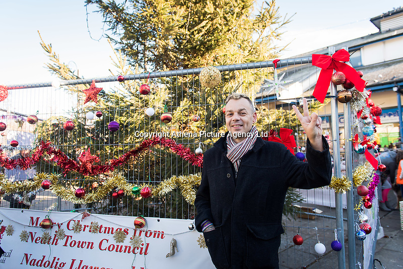 """Pictured: Darren Bromham-Nichols, who organised the decorating session. Saturday 03 December 2016<br /> Re: Residents are making their own decorations for Neath's Christmas tree this year after complaints about the town's festive decorations.<br /> Neath resident Darren Bromham-Nichols is calling on others to create their own decorations for the tree near the town centre, which has been described as """"bare with lots of dead wood."""", although the town council has said it has received no complaints.<br /> He hopes this will make Neath Town Council, who have funded the Christmas decorations for the town, take notice and help to decorate the tree."""