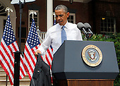 United States President Barack Obama removes his suit coat on a hot day before making a speech on a climate change at Georgetown University, Washington DC, Tuesday, June 25, 2013.  <br /> Credit: Dennis Brack / Pool via CNP
