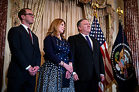 Mike Pompeo, U.S. secretary of state, his wife, Susan Pompeo, and their son, Nick, listen as U.S. President Donald Trump speaks, during a swearing-in ceremony for Pompeo, at the State Department, in Washington, D.C., U.S., on Wednesday, May 2, 2018. <br /> Credit: Al Drago / Pool via CNP /MediaPunch