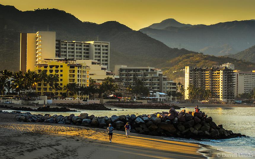 Fine Art Landscape Photograph of a golden sunrise in Banderas Bay, located in Puerto, Vallarta, Mexico.