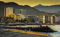 Fine Art Landscape Photograph of a golden sunrise in Banderas Bay, located in Puerto, Vallarta, Mexico.