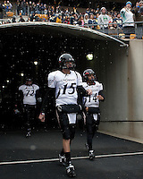 Cincinnati Bearcats quarterback Tony Pike (15) takes the field. The Cincinnati Bearcats defeated the Pittsburgh Panthers 45-44 in the final seconds of the River City Rivalry in a contest for the Big East Championship and a major bowl bid on December 5, 2009 at Heinz Field, Pittsburgh, Pennsylvania. .