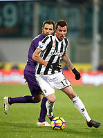 Calcio, Serie A: Fiorentina - Juventus, stadio Artemio Franchi Firenze 9 febbraio 2018.<br /> Juventus' Mario Mandzukic (r) in action with Fiorentina's Milan Badelj (l) during the Italian Serie A football match between Fiorentina and Juventus at Florence's Artemio Franchi stadium, February 9, 2018.<br /> UPDATE IMAGES PRESS/Isabella Bonotto