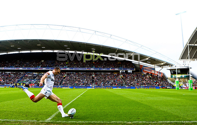 Picture by Alex Whitehead/SWpix.com - 02/11/2013 - Rugby League - Rugby League World Cup - England v Ireland - John Smith's Stadium, Huddersfield, England - England's Kevin Sinfield kicks for goal.