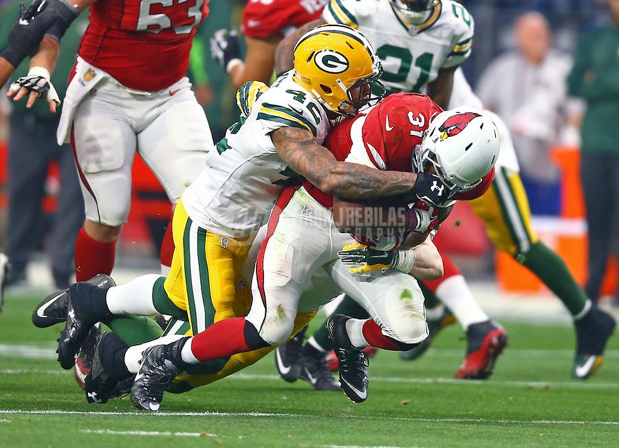 Dec 27, 2015; Glendale, AZ, USA; Green Bay Packers safety Morgan Burnett (42) tackles Arizona Cardinals running back David Johnson (31) at University of Phoenix Stadium. The Cardinals defeated the Packers 38-8. Mandatory Credit: Mark J. Rebilas-USA TODAY Sports