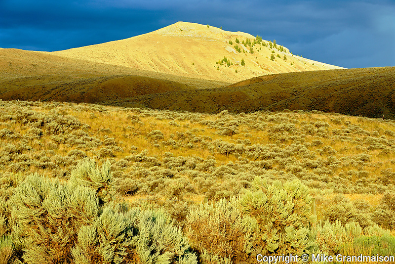 Storm light on grasslands, Cache Creek, British Columbia, Canada