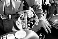 Valentino Rossi ai box del circuito di Brno prima della gara che lo vedrà vincere il suo primo mondiale 125cc nel 1997.