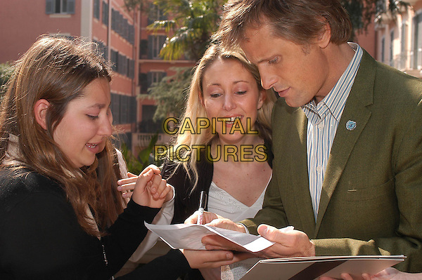 VIGGO MORTENSEN.Hidalgo photocall in Rome.17 March 2004.signing autographs.www.capitalpictures.com.sales@capitalpictures.com.© Capital Pictures.