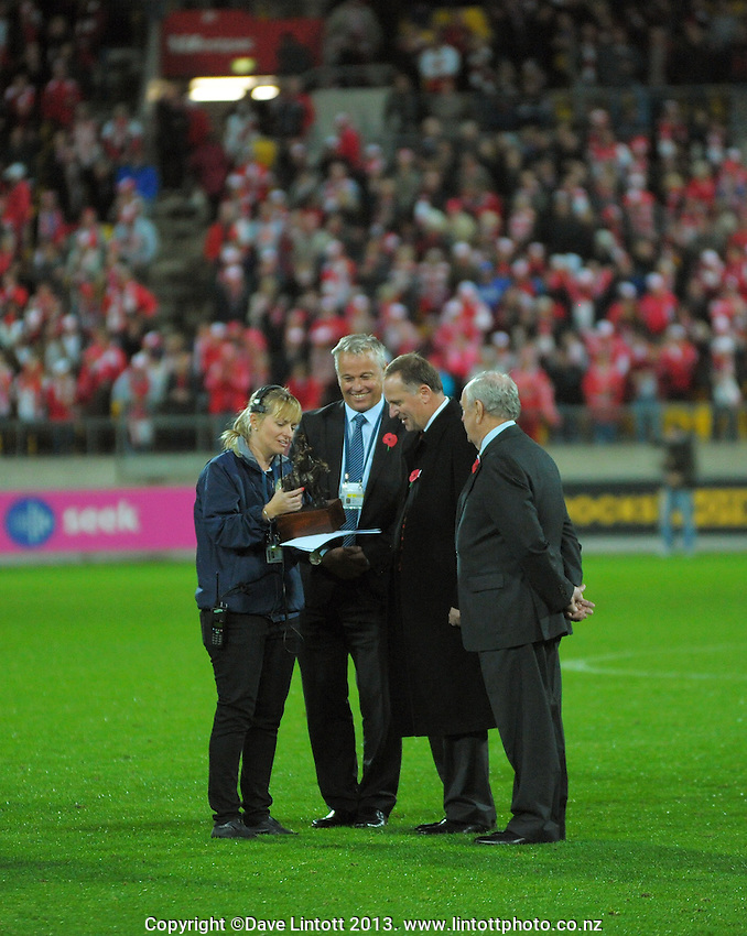 NZ prime minister John Key is given the Simpson-Henderson Trophy to present during the Australian Rules Football ANZAC Day match between St Kilda Saints and Sydney Swans at Westpac Stadium, Wellington, New Zealand on Thursday, 24 May 2013. Photo: Dave Lintott / lintottphoto.co.nz