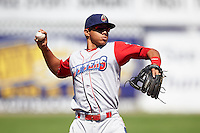 Williamsport Crosscutters third baseman Jan Hernandez (12) warmup throw to first during a game against the Batavia Muckdogs on July 16, 2015 at Dwyer Stadium in Batavia, New York.  Batavia defeated Williamsport 4-2.  (Mike Janes/Four Seam Images)