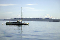 October 19, 2004:  A old weathered fishing boat could be seen tide down in the Manchester Marina.  Mt. Rainier could be seen in from a distance at the marina in Manchester, Washington. .
