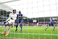 Tammy Abraham of Swansea watches on after he misses a header as he finds himself in free space in the box as Michel Vorm of Tottenham Hotspur watches on during the Fly Emirates FA Cup Quarter Final match between Swansea City and Tottenham Hotspur at the Liberty Stadium, Swansea, Wales, UK. Saturday 17 March 2018