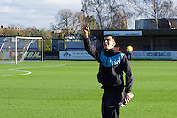 Luke O'Nien of Wycombe Wanderers checks the wind before the Sky Bet League 2 match between AFC Wimbledon and Wycombe Wanderers at the Cherry Red Records Stadium, Kingston, England on 21 November 2015. Photo by Alan  Stanford/PRiME.