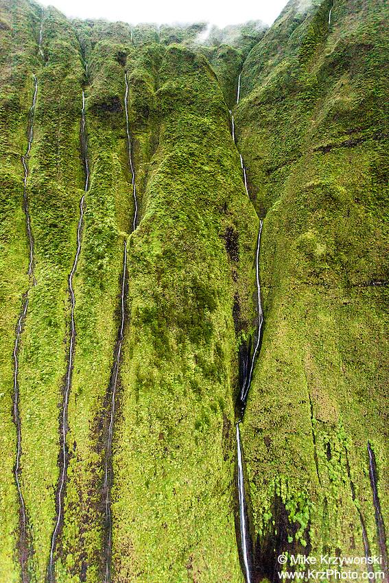 Aerial view of waterfalls flowing down cliff on Mt. Waialeale, Kauai